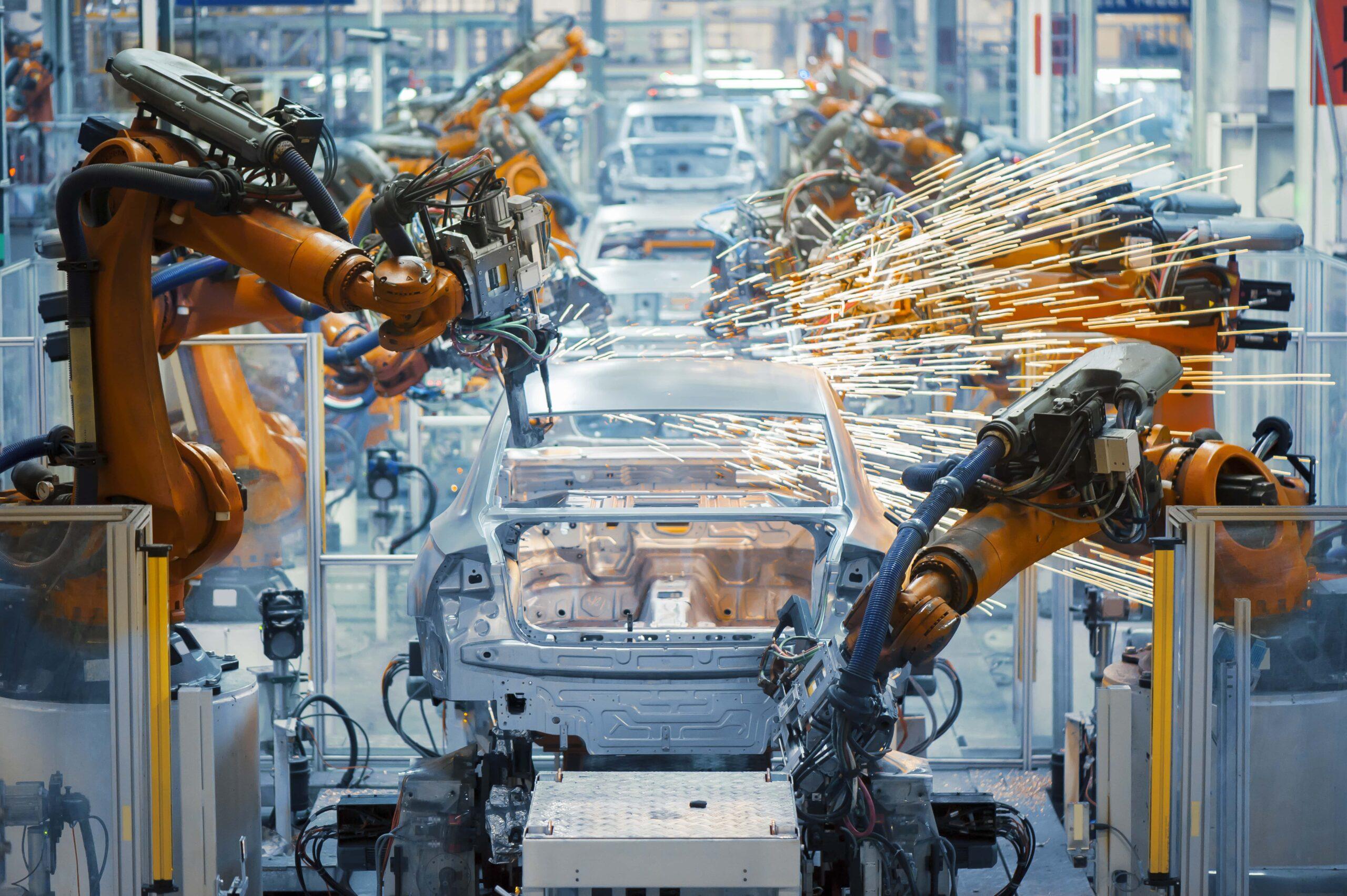 Automated mechanical arms building a car