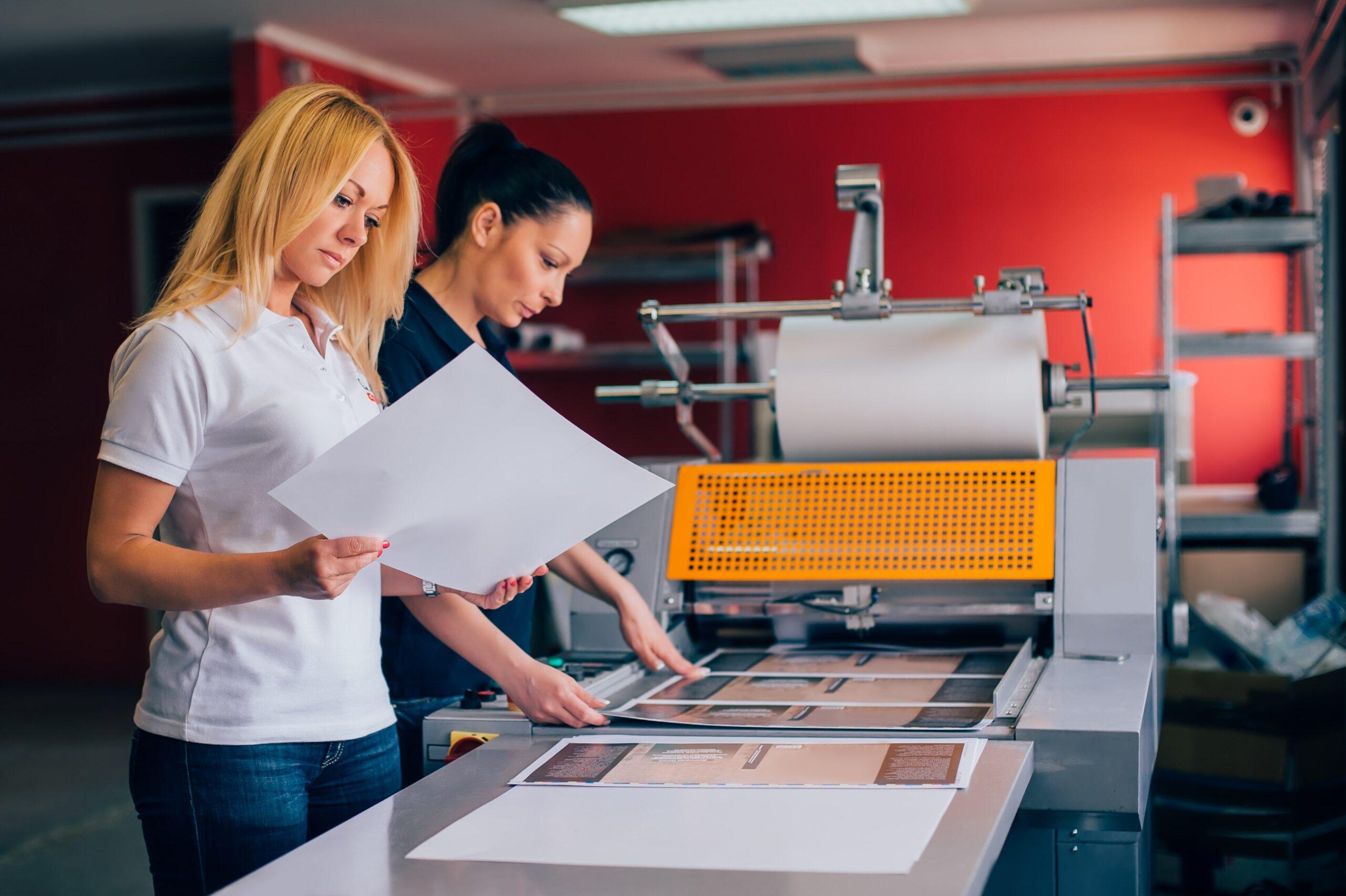 Two women at a printing press